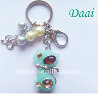 The animal shape with pearl fashion design keyring