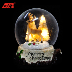 Led christmas glass snow ball with wooden base