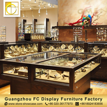Customized luxury apperance jewelry furniture rotating glass display cabinet jewellery showcase shop counter design