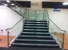 Indoor glass railings for stairs with round handrails