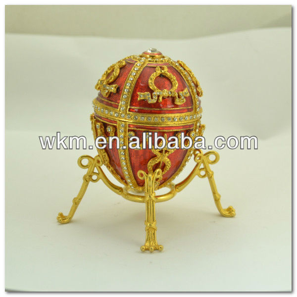 decorative metal eggshell studded with crystal stone faberge egg