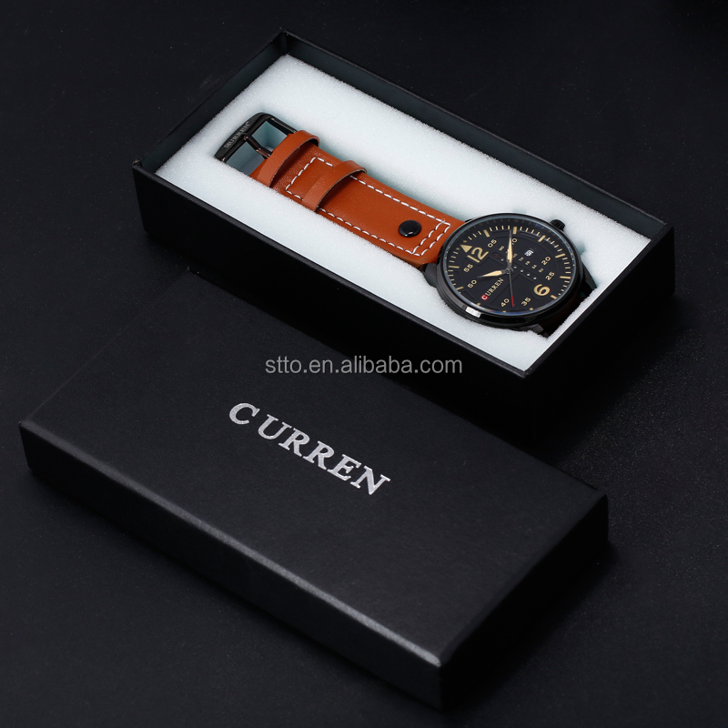 Small black watch box with insert inside and customs logo on the lid