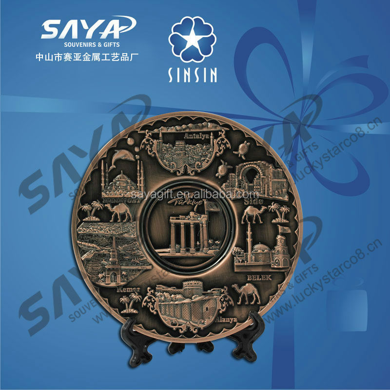 Souvenir gold plate with different city