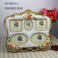 Polyresin 5 opening picture frame for home decor.