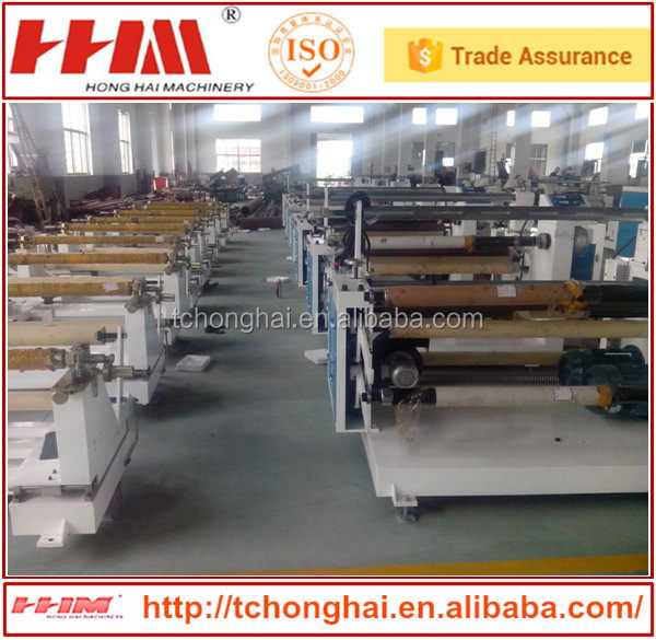 Automatic fabric slitting and winding machine