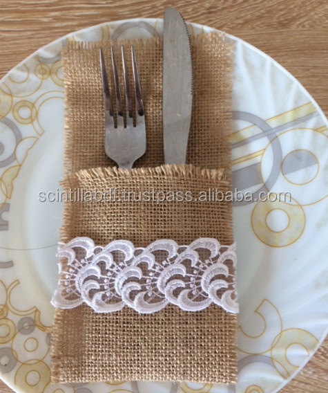 Burlap utensil holder with lace decoration for wedding