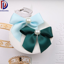 Wholesale hair accessories /gift packing ,pre-made green polyester satin ribbon bow with pearls