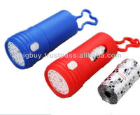 Flashlight with Carrying Bags of Dog Poop