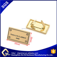 XINQI custom gold metal logo metal tags for bag accessories