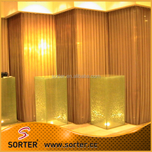 Sorter's metal coil drapery curtain wall backdrops