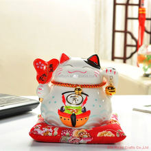 Beautiful pottery maneki neko for room decoration