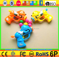 New design sport toys plastic ball shooting gun, soft bullet gun can load candy
