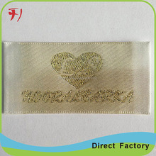Supply of foreign trade gold woven label for Zhongshan coat