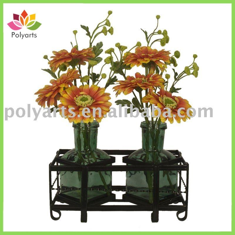 flower arrangement gerbera in bottle on metal rack