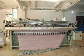Double carriage flat knitting machine