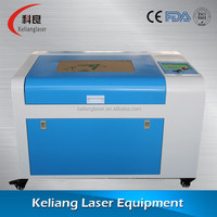 Lowest price Liaocheng co2 mini laser cutting machine price