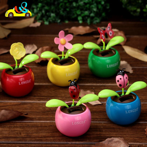 Hot sale cute cartoon type flower design solar dancing 2 green-leaves flower design quotes//