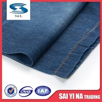 Cheap 100 cotton yarn dyed chambray denim fabric jeans item for women