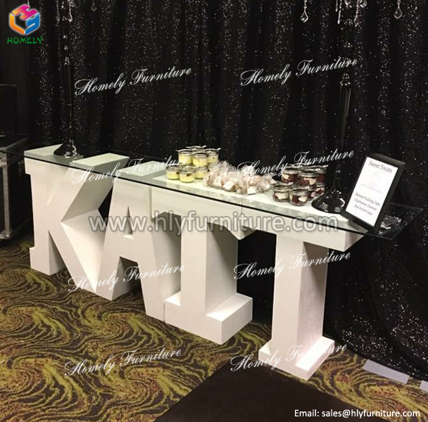 fancy white letter wood wedding table