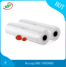 China low priceEmbossed plastic storage bag household food saver vacuum sealer roll and bags