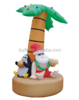 Inflatable Santa Claus and penguin with electric decorative palms tree Christmas decorations