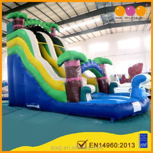 AOQI EN14960 certified commercial use palm tree outdoor inflatable water slide for sale