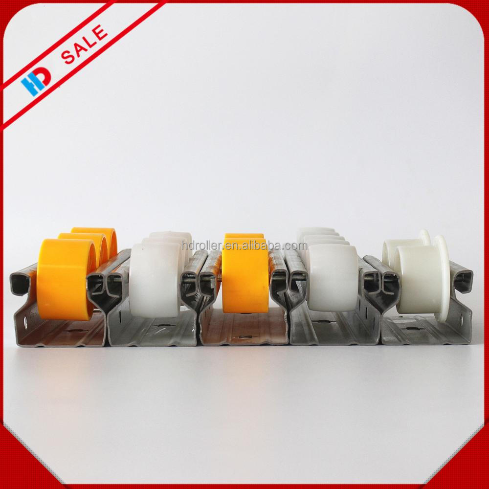 Plastic conveyor roller track for rack system