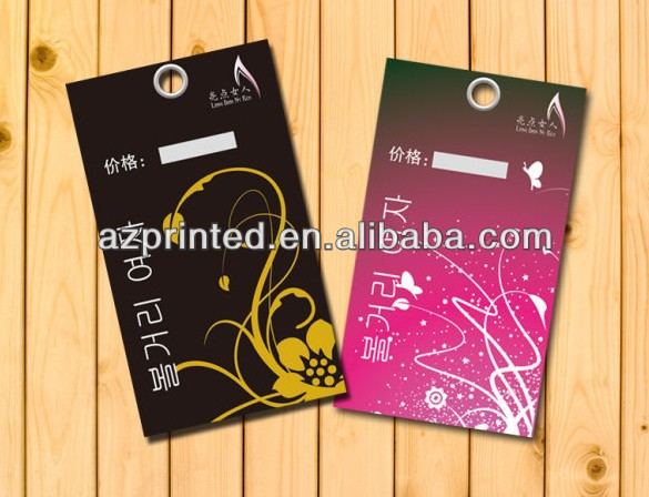white background paper hanging tag with black ribbon