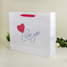 custom garment paper packing bag with you logo