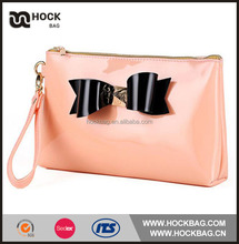 Fashional design plat bow flat handle clutch cosmetic pouch for young girl
