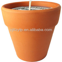 Citronella scented candle wax in ceramic pot