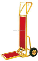Gold foldable hand bellman trolley luggage with red carpet