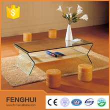 Modern glass top coffee table with stools