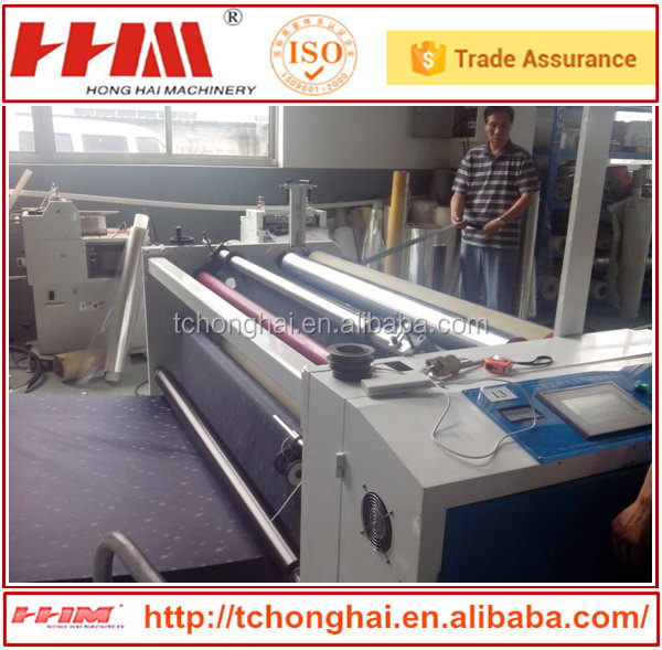 Plastic film jumbo reel slitting and rewinder machine