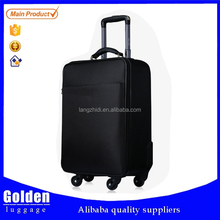 2015 hot selling electric luggage trolley black soft travel suitcase with 4 wheels luggage bag