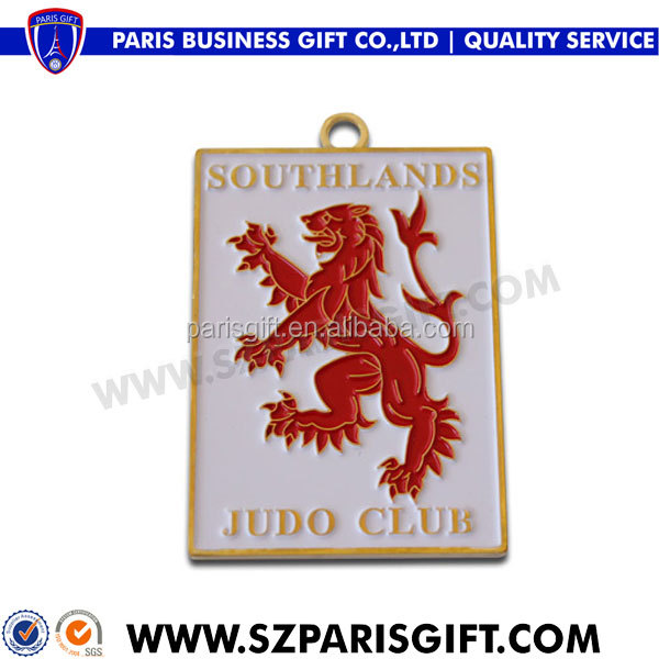 Southland metal judo medals with red enamel dragon logo
