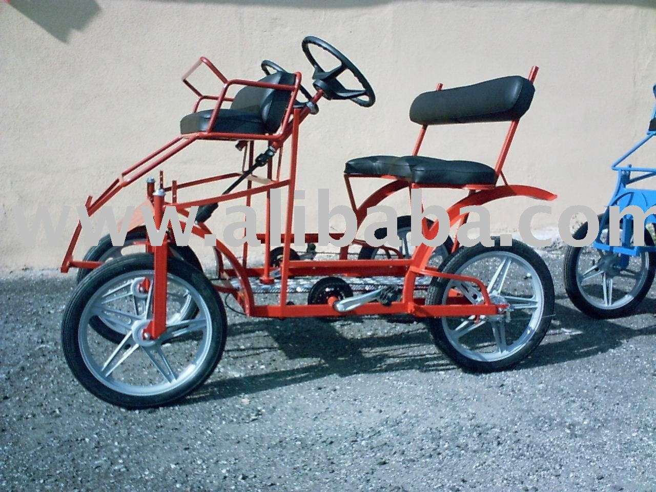 Red fourwheel Surrey bike