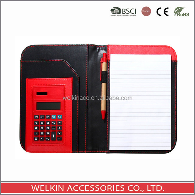 Notebook with ballpen and calculator