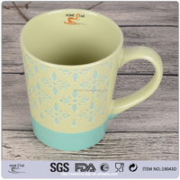 Promotional 12OZ ceramic coffee mugs with embossed designs