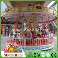 amusement rides big carousel with horse and carriage