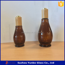 Wholesale unique shape 30ml 50ml amber essential oil bottles with Bamboo Dropper Cap