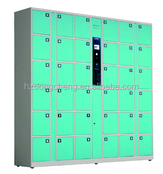 Coin operated cell phone charging electronic locker