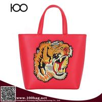 2016 the most popular handbag tiger Embroidered paste hand handbag brand famous