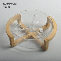 clear large round glass salad bowl with wooden stand
