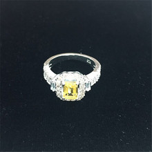 925 sterling silver ring with yellow emerlad cut cubic zirconia main stone