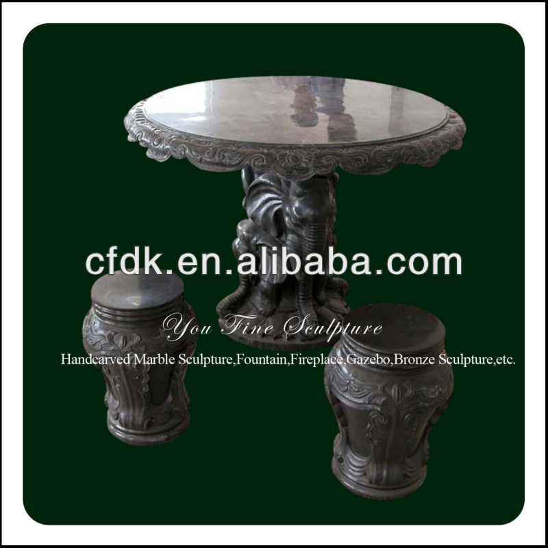 Polished hand carved black stone top patio table and chairs