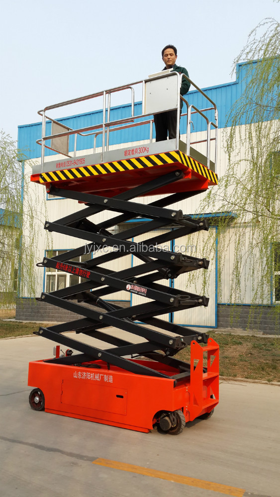 Skyscraping Tower hot sell hydraulic self-propelled scissor lift table 300kg loading weight electric aerial working platform
