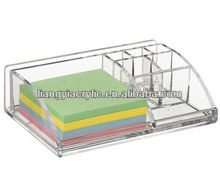 Clear acrylic notepaper organizer with dividers and pockets to hold pens