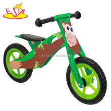 Wholesale best gift ride on toy wooden cartoon green balance bike for baby W16C064