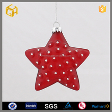 Hanging red glass star ornament for christmas tree
